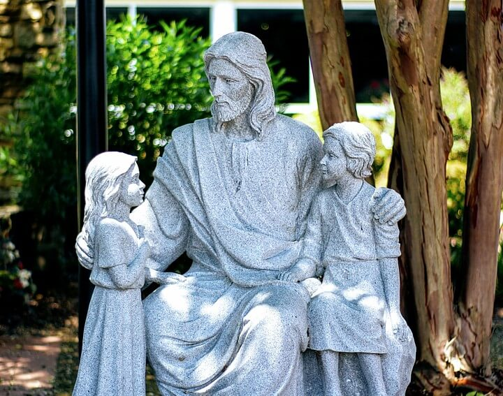 Statue of Jesus with children.